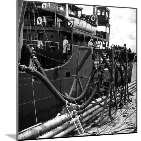 El Barco Oil Being Piped into Texaco and Socony-Vacuum Tankers--Mounted Photographic Print