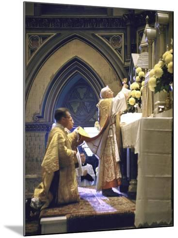 Cardinal Stritch Elevating Chalice after Transubstantiation During Mass-John Dominis-Mounted Premium Photographic Print