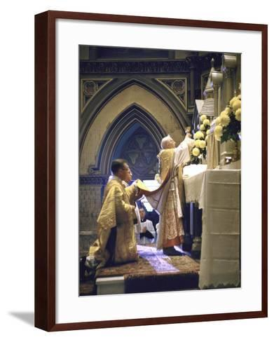Cardinal Stritch Elevating Chalice after Transubstantiation During Mass-John Dominis-Framed Art Print