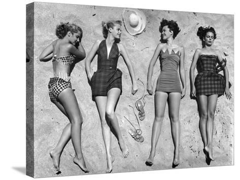Models Lying on Beach to Display Bathing Suits-Nina Leen-Stretched Canvas Print
