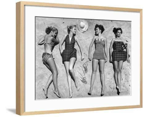 Models Lying on Beach to Display Bathing Suits-Nina Leen-Framed Art Print