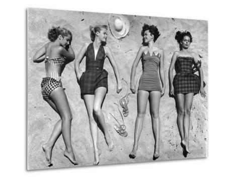 Models Lying on Beach to Display Bathing Suits-Nina Leen-Metal Print