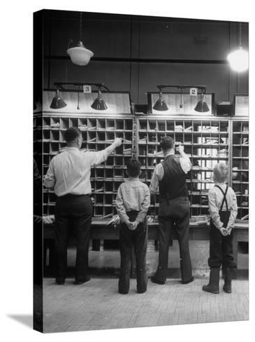 Boys Watching Postal Workers Sorting Mail-Nina Leen-Stretched Canvas Print