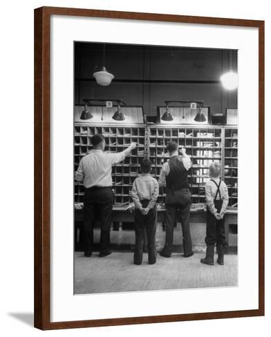 Boys Watching Postal Workers Sorting Mail-Nina Leen-Framed Art Print