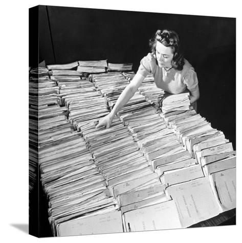 File Clerk at the Fbi Working with a Table Covered with Files--Stretched Canvas Print