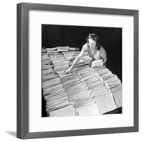 File Clerk at the Fbi Working with a Table Covered with Files--Framed Art Print