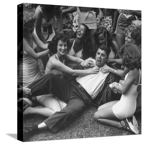Contest Judge Ken Murray Being Wrestled to the Ground by Contestants in Beauty Pageant-Peter Stackpole-Stretched Canvas Print
