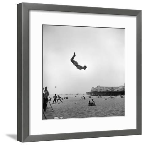 Man Flying Off a Trampoline at Santa Monica Beach-Loomis Dean-Framed Art Print