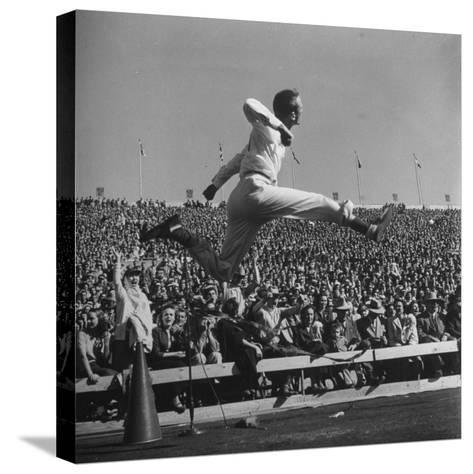 Smu Cheerleader Leaping High into Air at University of Texas Football Game-Loomis Dean-Stretched Canvas Print