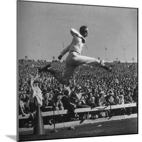 Smu Cheerleader Leaping High into Air at University of Texas Football Game-Loomis Dean-Mounted Photographic Print