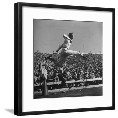 Smu Cheerleader Leaping High into Air at University of Texas Football Game-Loomis Dean-Framed Art Print