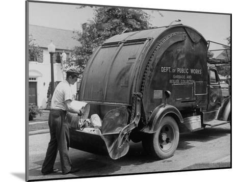 Garbage Man Emptying Trash into Back of Garbage Truck-Alfred Eisenstaedt-Mounted Photographic Print