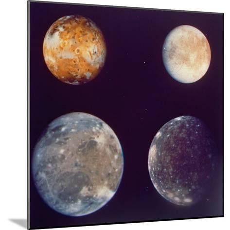 Jupiter's Satellites Io, Europa, Ganymede and Callisto as Depicted by Voyager 1 Spacecraft--Mounted Photographic Print