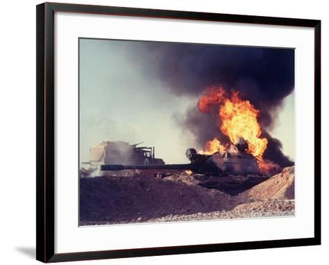 Iraqi Tank Burning While US Army Convoy Drives Past into Iraq During Gulf War-Ken Jarecke-Framed Art Print
