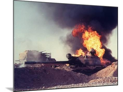 Iraqi Tank Burning While US Army Convoy Drives Past into Iraq During Gulf War-Ken Jarecke-Mounted Photographic Print