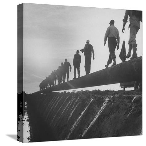 Men Laying Pipeline--Stretched Canvas Print