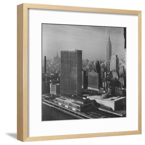 Sky Shot of the Un Headquaters and the Empire State Building-Dmitri Kessel-Framed Art Print