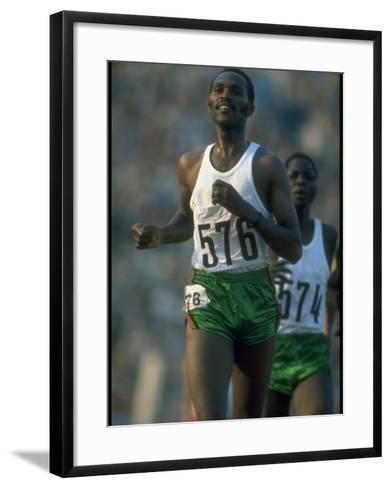 Track Athlete Kip Keino in Action at the Summer Olympics-John Dominis-Framed Art Print