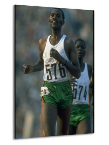 Track Athlete Kip Keino in Action at the Summer Olympics-John Dominis-Metal Print