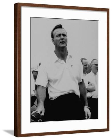 Golf Pro Arnold Palmer Putting Hand on Clubs Between Shots During Tournament--Framed Art Print