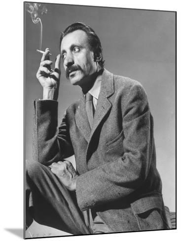 Armenian Artist Arshile Gorky Holding a Cigarette-Gjon Mili-Mounted Premium Photographic Print