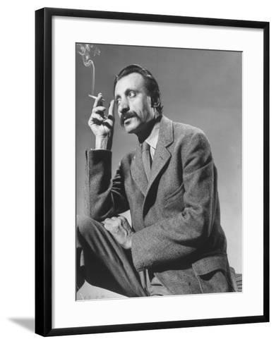 Armenian Artist Arshile Gorky Holding a Cigarette-Gjon Mili-Framed Art Print