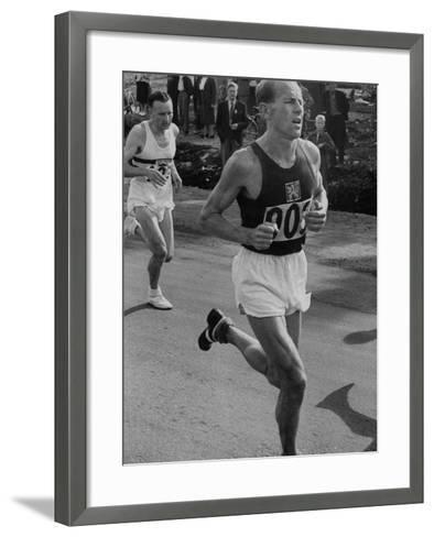Emil Zatopek Running in Marathon at 1952 Olympics--Framed Art Print