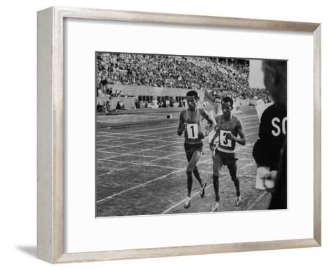 Abebe Bikila and Mamo Wolde in Exhibition Race at Berlin Olympic Stadium--Framed Art Print