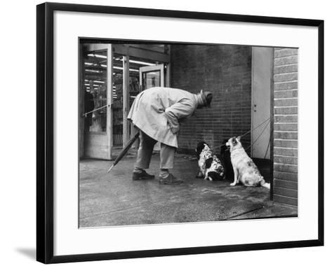 French Actor Jacques Tati Talking to a Couple of Dogs-Yale Joel-Framed Art Print