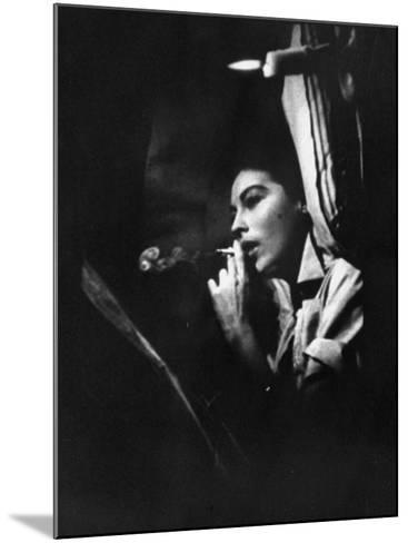 """Actress Ava Gardner Smoking a Cigarette in a Scene from the Film """"Mogambo""""-Peter Stackpole-Mounted Premium Photographic Print"""