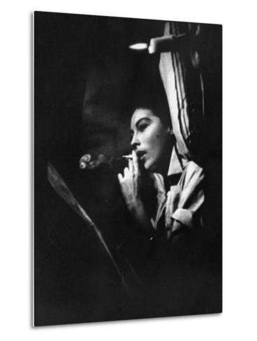 """Actress Ava Gardner Smoking a Cigarette in a Scene from the Film """"Mogambo""""-Peter Stackpole-Metal Print"""