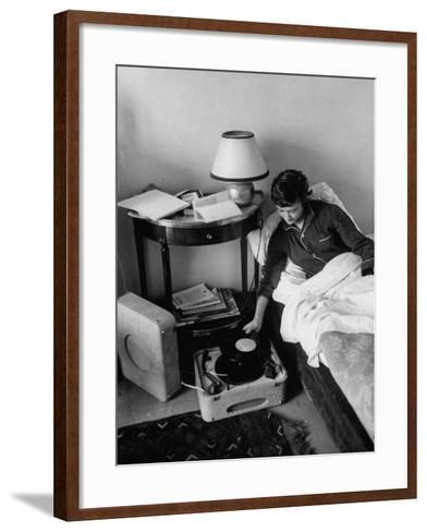 French Authoress Francoise Sagan, Laying in Bed Listening to Music--Framed Art Print