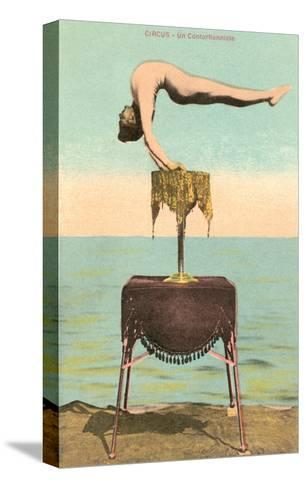 Circus Contortionist at Beach--Stretched Canvas Print