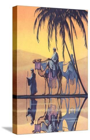 Arabs on Camels Along the Nile--Stretched Canvas Print
