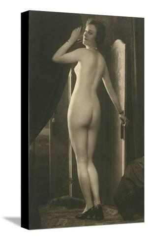 Coy Nude at Wardrobe Door--Stretched Canvas Print
