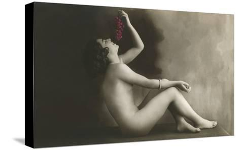 Naked Woman Eating Grapes--Stretched Canvas Print