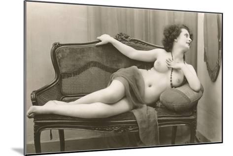 Semi-nude Woman on Cane Divan Looking in Mirror--Mounted Art Print