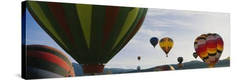 Hot Air Balloons in the Sky, Taos, New Mexico, USA--Stretched Canvas Print
