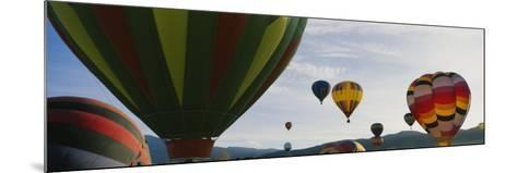 Hot Air Balloons in the Sky, Taos, New Mexico, USA--Mounted Photographic Print