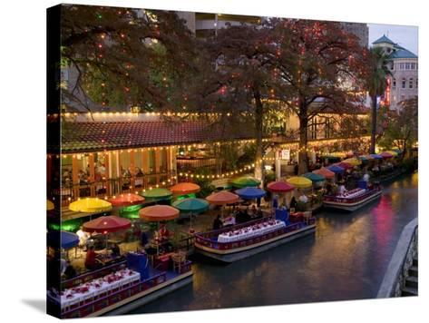 Restaurant Along a River Lit Up at Dusk, San Antonio River, San Antonio, Texas, USA--Stretched Canvas Print