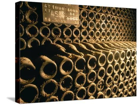 Close-up of Wine Bottles in a Cellar of Bollinger, Ay, Champagne, France--Stretched Canvas Print
