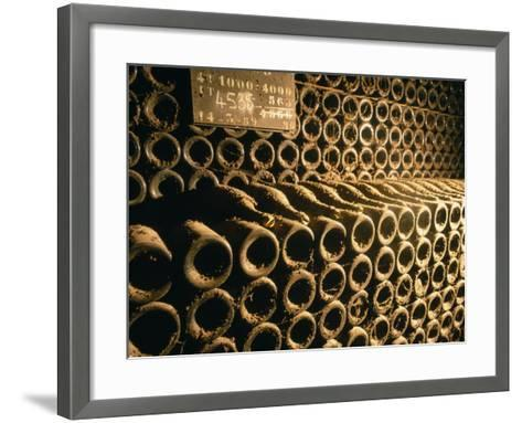 Close-up of Wine Bottles in a Cellar of Bollinger, Ay, Champagne, France--Framed Art Print