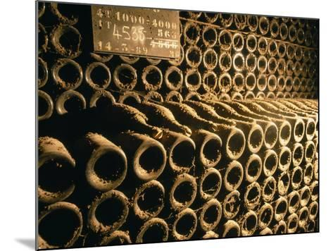 Close-up of Wine Bottles in a Cellar of Bollinger, Ay, Champagne, France--Mounted Photographic Print
