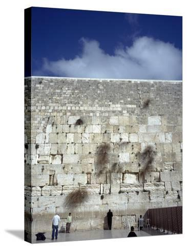 Group of People Praying in Front of a Wall, Western Wall, Jerusalem, Israel--Stretched Canvas Print