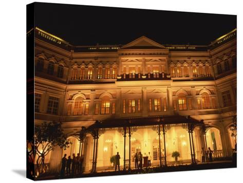 Facade of the Raffles Hotel at Night in Singapore, Southeast Asia-Steve Bavister-Stretched Canvas Print