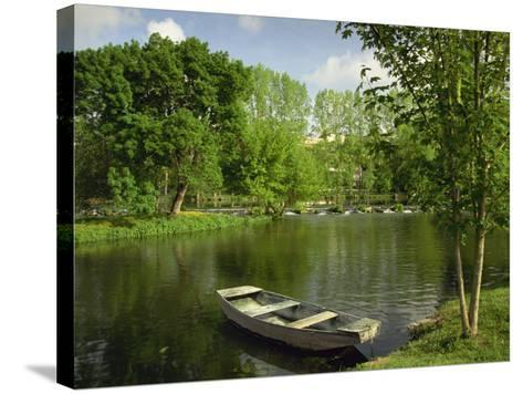 Boat on the River Charente, St. Simeux, Poitou Charentes, France, Europe-Michael Busselle-Stretched Canvas Print