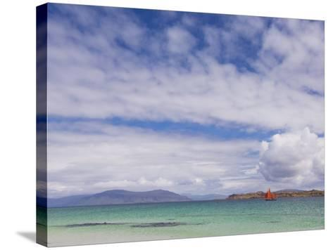 Boat with Red Sails Off Traigh Bhan Beach, Iona, Sound of Iona, Scotland, United Kingdom, Europe-Neale Clarke-Stretched Canvas Print