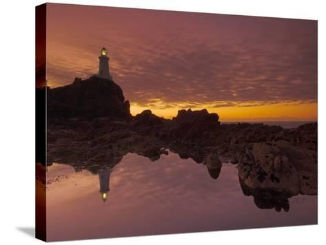Dramatic Sunset and Low Tide, Corbiere Lighthouse, St. Ouens, Jersey, Channel Islands, UK-Neale Clarke-Stretched Canvas Print