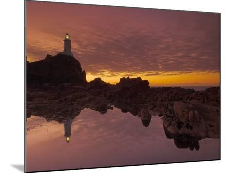 Dramatic Sunset and Low Tide, Corbiere Lighthouse, St. Ouens, Jersey, Channel Islands, UK-Neale Clarke-Mounted Photographic Print