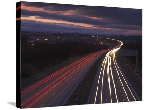Traffic Light Trails in the Evening on the M1 Motorway Near Junction 28, Derbyshire, England, UK-Neale Clarke-Stretched Canvas Print